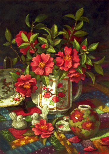 Red camelias spill out of a decorated teapot