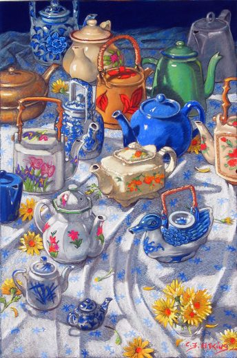 About twelve teapots of various shapes are standing on a white patterned cloth.