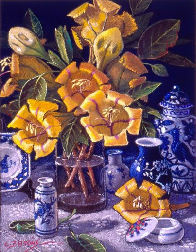 Large yellow solandra flowers with blue pottery