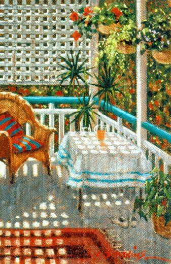 Dappled light on a table on a verandah.