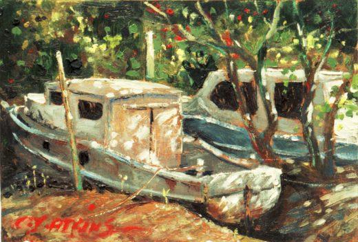 Boats in dapp;ed light in Wynnum Creek