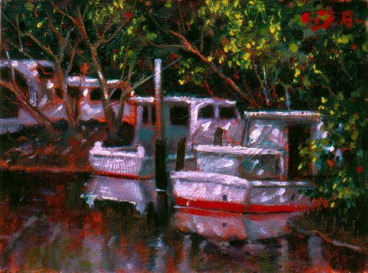 Boats under the mangroves in Wynnum Creek.