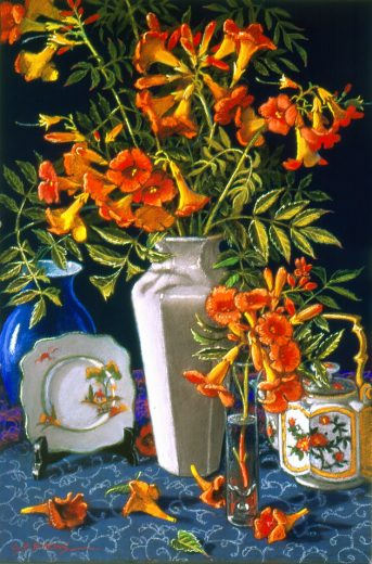Bright Orange Trumpet flowers in a white vase, with teapot and plate.