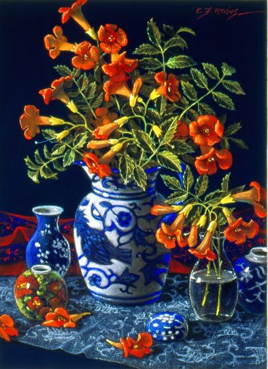 Blue and white pottery vase with bright orange flowers.